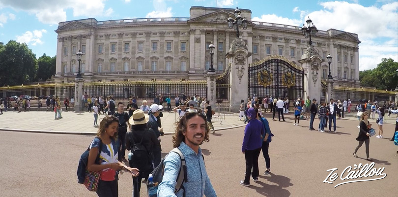 Visit the Buckingham palace and its guards in the Westminster district of London