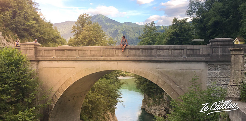 Romain on the Napoleon bridge in Kobarid, Slovenia, during our roadtrip in Slovenia by van.