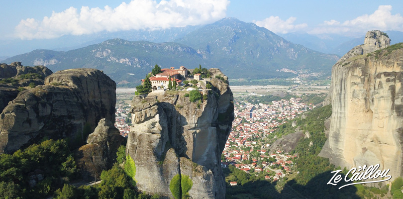 Triada monastery in the Meteora site in Greece with a van.