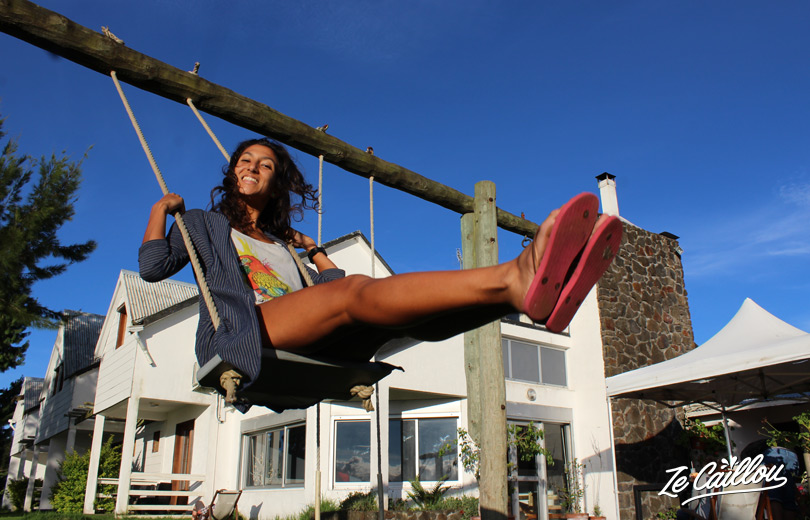 We enjoy the swings in the les Géraniums hotel's garden at la Plaine des Cafres.