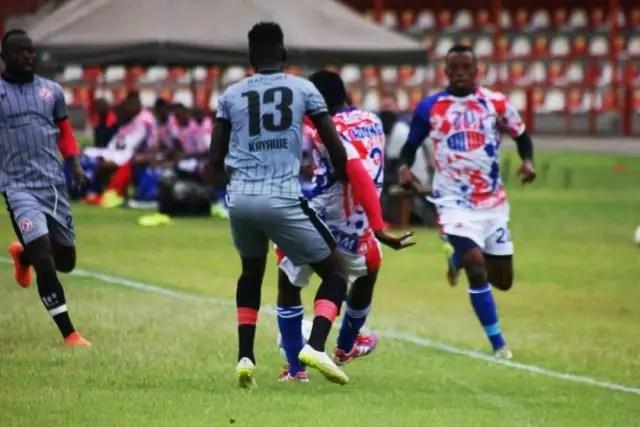 Kayawe Kapota defend against Buildcon during the MTN FAZ super league week encounter