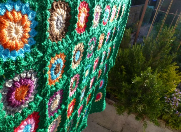 green blanket hung up