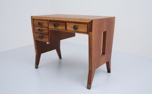 A writing desk by Gio Ponti for Schrirolli in Walnut and Brass feet, Italy, 1950's