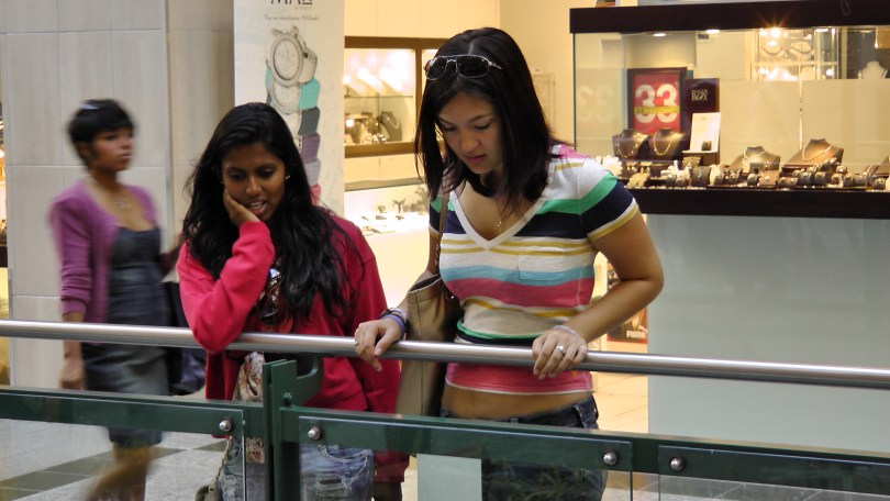 """Some more shoppers looking at """"Fragile"""" by Roadsworth and Brian Armstrong at the Eaton Centre."""
