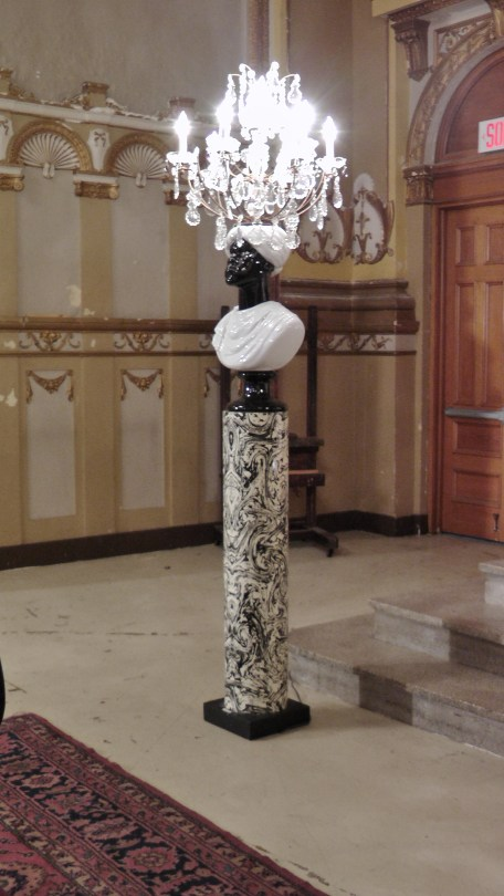 """A """"rare pair of Moor floor lamps. Glass and gilt metal chandeliers on glazed porcelain Moor busts on enameled metal pedestal. Milano, Italy circa 1960."""" Made by Piero Fornasetti."""