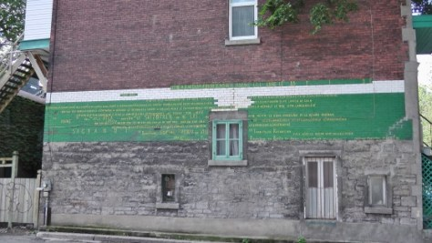 Writing on the wall of an alley off of Square Saint Louis.