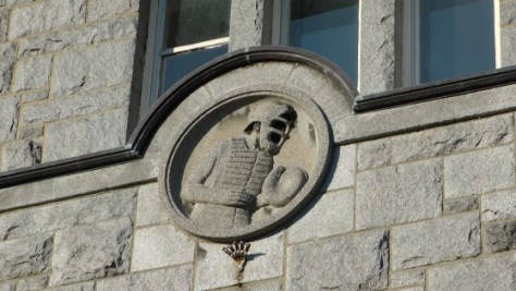 Baseball player bas-relief above an entrance to the Centre Culturel Calixa-Lavallée