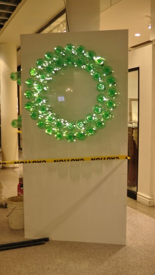 A wreath made out of recycled soda bottles.