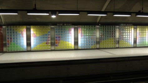 Glass Bricks concealing a mural by Marcelin Cardinal.