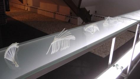 "Elisabeth Picard, Constructions, 2011, zip ties, glass, painted steel, fluorescent tubes, 48"" x 147"" x 10"""