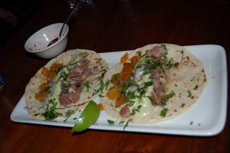 Duck, pineapple and mild chile poblano sauce tacos from Restaurant Cartel