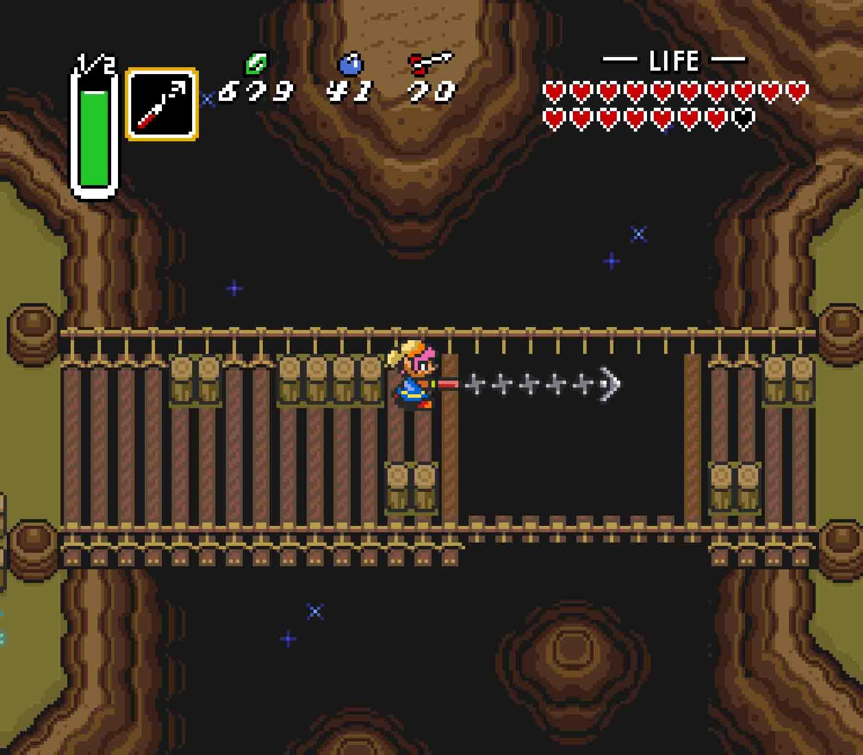 Cross the broken bridge to eastern Death Mountain using the Hookshot.