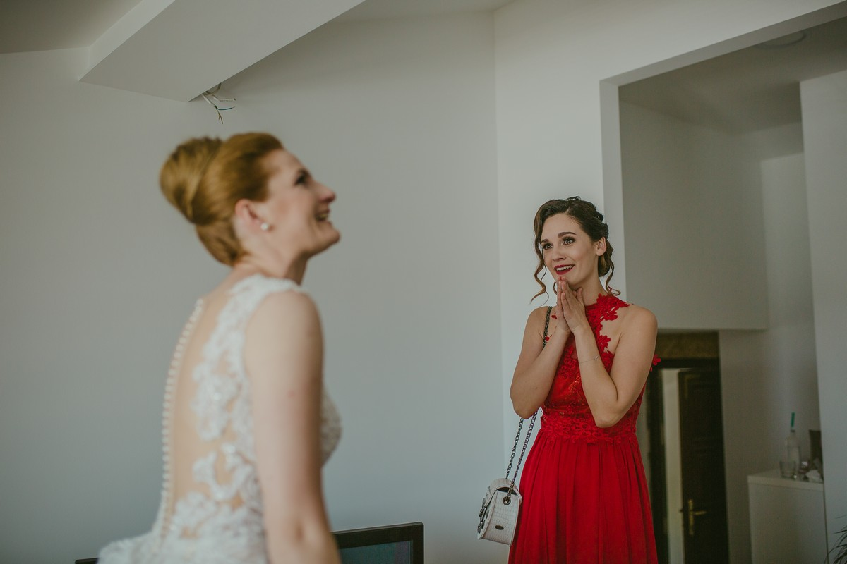 Maid of honour and bride happy