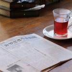 各席に『日本一心を揺るがす社説の新聞』