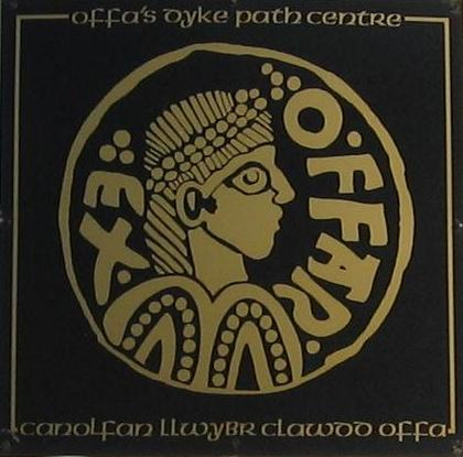 Logo from Offa coin (OFFA REX) as displayed on Offa's Dyke Path Centre at Prestatyn, Wales