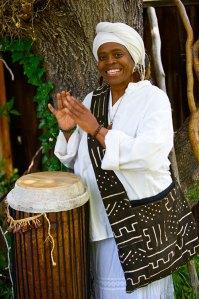 Zenju Earthlyn Manuel playing a drum