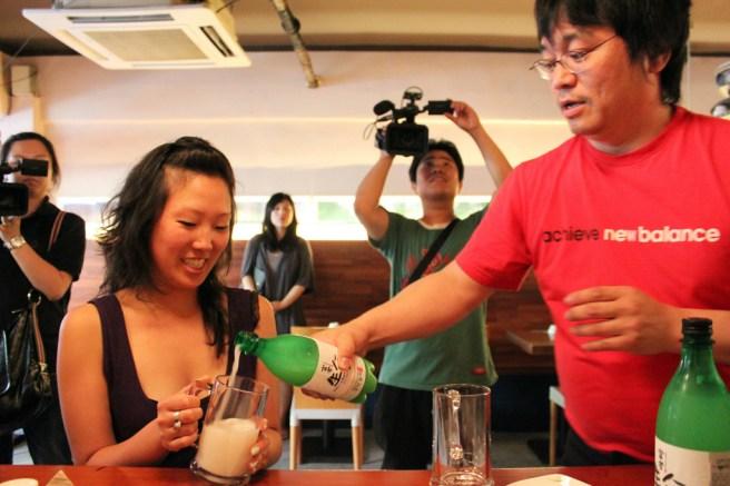 Pouring makkoli at Chin Chin