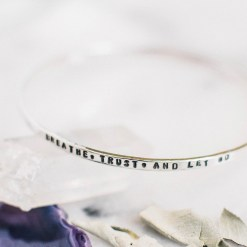 Breathe trust and let go Sterling silver bangle