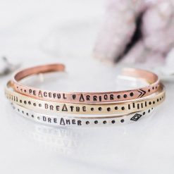 Inspirational skinny cuff set with patterns in copper brass and sterling silver