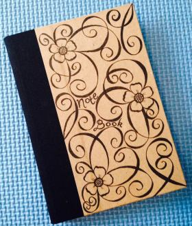 Notebook with flowers and tendrils