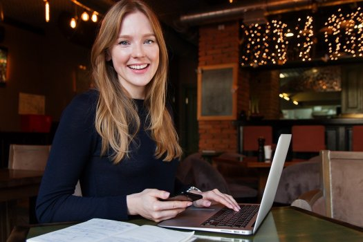 Business Woman with black shirt and laptop