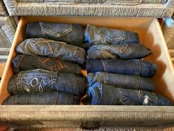 Photo of jeans folded and placed upright in drawer. Marie Kondo's KonMari method