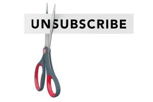 Cutting Unsubscribe to Subscribe Paper Sign with Scissors on a white background