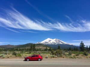 My red Mazda in front of Mount Shasta. I used some great packing hacks to fit in everything I needed!