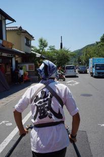 Our rickshaw driver pulling us through the streets of Arashiyama