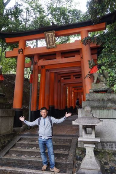 Me at the torii gates before our hike to the top of Mt Inari