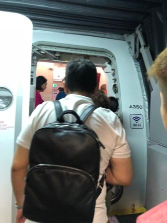 Attendants greeting passengers during boarding