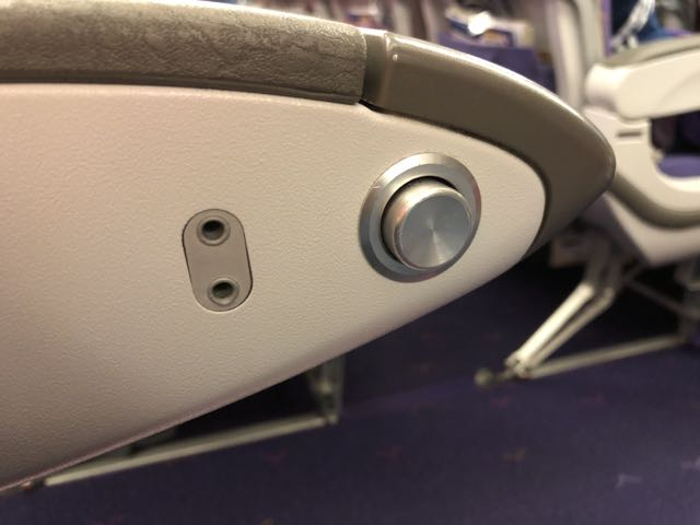 Seat recline button and headphone jack is found on the left armrest