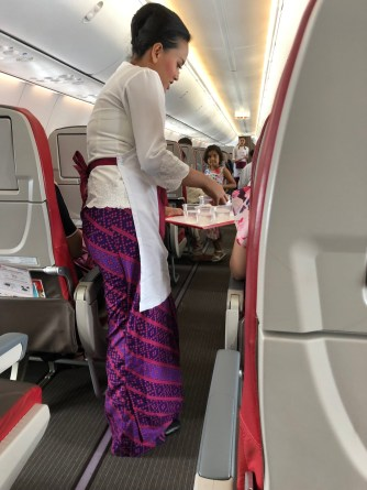 Flight attendant during drink service