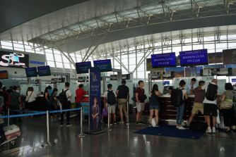There are four queues for Singapore Airlines passengers