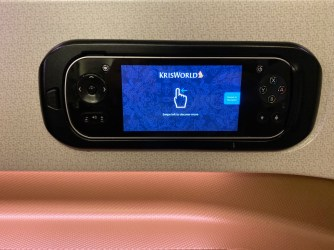 The touchscreen IFE controllers are stored on the side of the sear