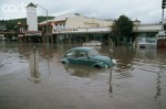 1983, Laguna Beach, California, USA --- Floods from the El Nino Storm of 1983, engulf a blue Volkswagen Bug, parked on a shopping street in Laguna Beach. California, USA. --- Image by © Vince Streano/CORBIS
