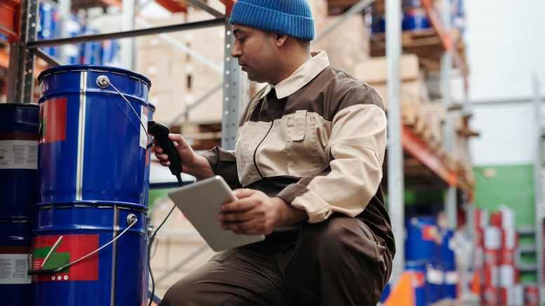 photo of man scanning a bucket
