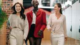 successful multiethnic business colleagues in modern office
