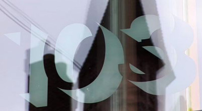Close up of 103 etched into the glass above the door at zero carbon house, Birmingham