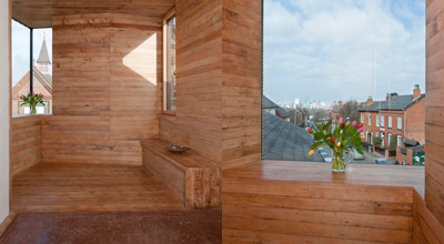 The wooden alcove in the studio in zero carbon house, Birmingham showing the view over Tindal St