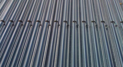 Close up of the cylinders used to heat up the hot water on the roof of zero carbon house, Birmingham
