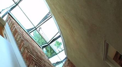 The glass roof, seen from below, with light streaming in at zero carbon house. Birmingham