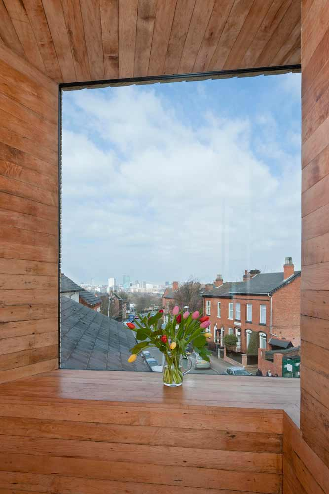 Tulips on the window sill of the studio at zero carbon house, Birmingham showing the Birmingham skyline and Tindal Street