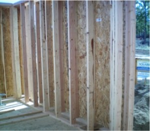 Double wall construction in a net zero energy home building