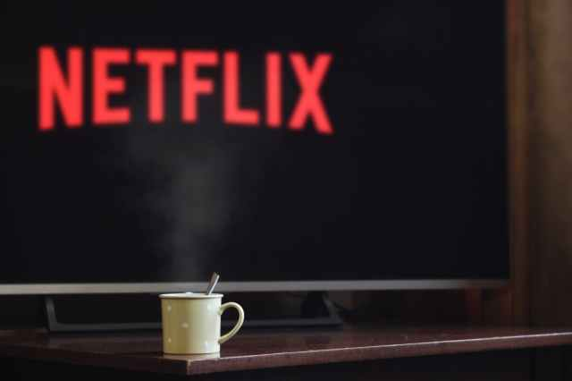Netflix and coffee cup