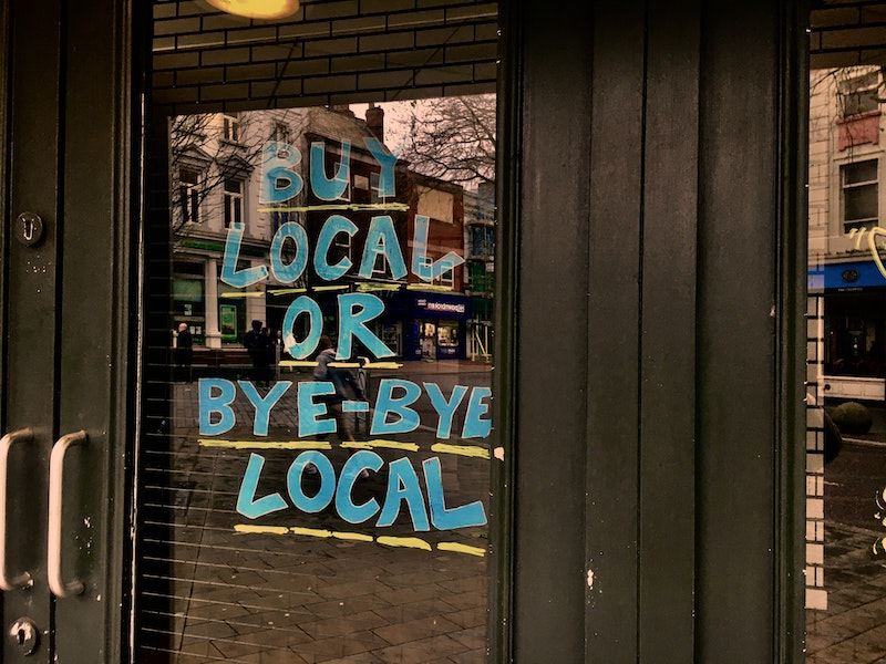 Buy local or buy less