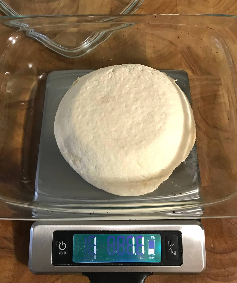 one pound of homemade tofu on a scale