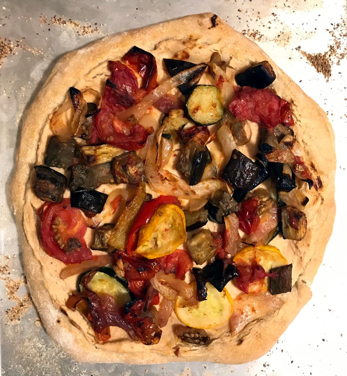 sourdough pizza topped with cashew cheese and leftover ratatouille