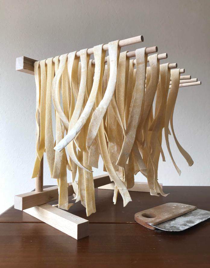 pasta drying on a pasta rack