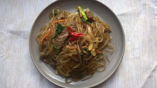 Stir-fried beef and vegetables with glass noodles (Japchae)